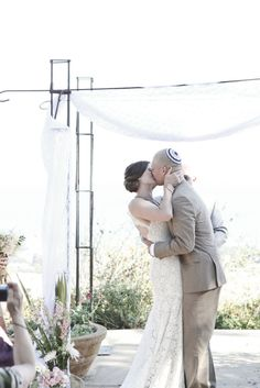 Ceremony kiss // Malibu Wedding by All You Need is Love Events // Photography by Jennifer Roper Photography