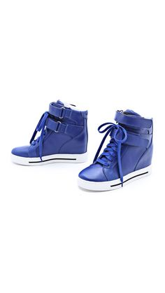 Hi-top Marc by Marc Jacobs sneakers are fashioned with a classic leather upper and a contrast rubber sole. The hidden wedge heel and double ...