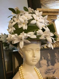 On my, this hat makes such a fashion statement. , Dainty white flowers with green petals adorn green velvet, lace lining, looks like its never been worn  CONDITION: excellent  MEASUREMENTS: height: 11  circumference of crown: 20 1/2     Items are pre owned vintage, sales are final Enjoy