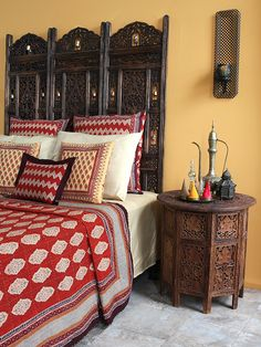 Unique Red Orange Luxury Moroccan QUILT BEDSPREAD: A spicy melange of colors makes the Spice Route bedspread both decorative and warming. Made of the softest cotton, it is perfect as a light coverlet to stay cool under, during the hot summer month. Layer with sheets and blankets underneath as the weather cools and add candle lanterns and hanging lamps to experience a little bit of Morocco in your bedroom.