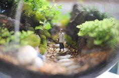 Mini-jardín con personajes de ferromodelismo