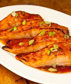 Marinated Salmon  1/4 c. olive oil  3 T. soy sauce  onion  2 t. ginger  2 cloves garlic  Mix ingredients and pour over salmon. Marinate up to 1 hr. Bake at 350 for 15-20 until salmon flakes easily.