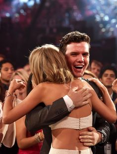 Pin for Later: 45 Celebrities Who Can't Believe They're Hugging Taylor Swift Austin Swift