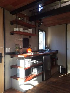 Contemporary in concept, the tiny house is a complete retreat space, with kitchen, stove, microwave, and small fridge.