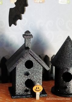 Unfinished wooden birdhouses, $1 each  Black acrylic or spray paint, on hand or $1 and up  Glitter spray paint, about $6  Masking tape (optional), on hand