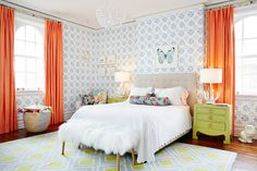 This bedroom is too cute! Love how the shades of orange, blue, & lime green create a bright, happy space. Plus that chandelier is absolutely gorgeous!