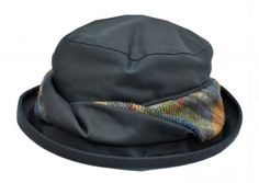 A very smart medium brimmed wax hat with an attractive twisted tweed trim round the edge of the hat. Fully waterproof  with a cosy micro fleece lining for warmth.   $55.26