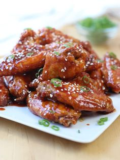 Spicy Baked Korean Chicken Wings - An Asian inspired baked wings recipe, perfect as appetizer and dinner! A fun party food for game day as well! Crispy chicken coated with spicy, flavorful gochujang based sauce. Honey Sriracha Chicken Wings, Spicy Korean Chicken, Korean Chicken Wings, Fried Chicken Wings, Asian Chicken, Hawaiian Chicken, Korean Chilli Paste, Cream Cheese Wontons, Crispy Baked Chicken