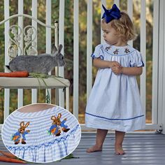"""Storybook Rabbit Smocked Dress Blue Stripe Seersucker Pre-Order shipping by March 16th, 2015 Brand: Classic Whimsy.   Price: $34.99 Options: 3M, 6M, 9M, 12M, 18M, 24M, 2T, 3T, 4T, 5, 6, 7  To bid, comment with """"Sold, size, email address""""."""