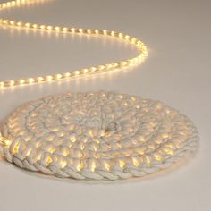 led light rope encased in chunky knitting,  no instructions diy inspiration,  I wonder how it would stand up to being stepped on.