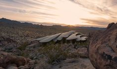The Desert House, California - Like an armadillo, this Joshua Tree estate by architect Ken Kellogg features a layered roofing structure that shields it from the harsh wind and heat of the desert. Using concrete, glass, copper, and steel, the home looks like something that grew organically out of the rock and sand.