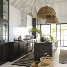 Vaulted ceiling in kitchen allows for unexpected oversized lights over the island.