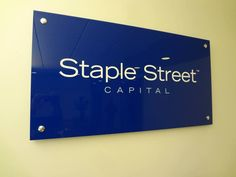 Custom blue plexiglass panel sign with flat digital graphics and mounted with stainless steel standoffs off wall in NYC. For more information on office wall signage, visit http://www.SignsVisual.com