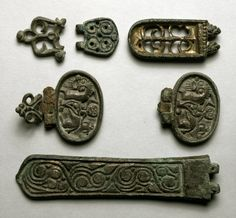 artofthedarkages: Buckles, hinges, and fittings with openwork and incised designs of swirls, plants, and horsemen. Forged out of leaded tin and bronze. Made in the 8th-9th century for an Avar nobleman in Austria. Currently located at the British Museum.