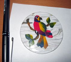 A parrot made with insructions from Sue Heaser's polymer technique book. It took some three hours to finish that bird.