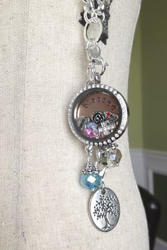 "Origami Owl Large silver locket with crystals, silver extender, large silver tree of life dangle, aqua crystal dangle, custom silver rolo chain, Large rose gold ""blessed"" plate, vintage rose charm, silver crystal cross charm, family heart charm, love my dog charm, and birthstones"