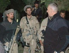 U.S. Army Special Forces Soldiers of the 5th Special Forces Group (SFG), meet Gen. Tommy Franks, CENTCOM commander charged with leading the attack on the Taliban and Al Qaeda in Afghanistan, 2001. Special Forces were instrumental in achieving victory in the campaign. Note the Special Purpose Rifle (SPR) carried by the soldier on the left.(DOD photo, public domain)