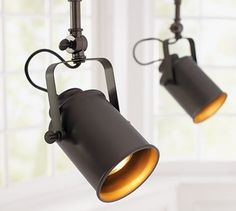 I would LOVE to have these in the piano room! Photographer's Spotlight Track Lighting #potterybarn
