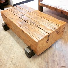 coffee table of reclaimed hand hewn pine timbers with a clear satin poly