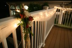 tulle draped w/ white Christmas lights to highlight the porch for an evening wedding.