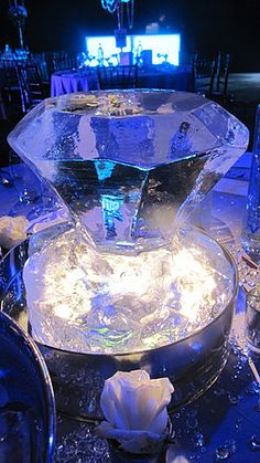 Wedding Ice sculpture table centres, ice champagne bucket, ice statues, ice carvings, ice luges for all UK events corporate and hospitality.