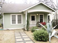 Like this light mint green with white trim (exterior house painting ideas)