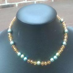 halsketting van Champagne kleurige glaskristallen met goudkleurige hematiet (44cm) 12€