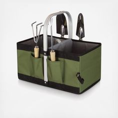 The Garden Caddy is like no other novelty gardening gift item you will find. It's an outdoor garden basket that has a stationary aluminum handle onto which a durable and expandable polyester body is sewn. Four individual pockets strategically sewn onto the expanded exterior of the basket hold four convenient gardening tools that don't get in the way when the basket is folded. Fold the base panel upward, and the basket condenses onto itself for compact storage and portability. Gardenin...