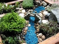 great idea to use coloured stones rather than water - especially with children!!