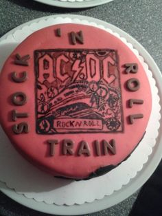 """Acdc rock'n roll train cake for a friend who's called """"Stock""""."""