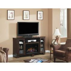 Stay warm during the cold weather with an electric fireplace built into a media console.
