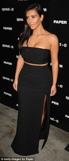 Exotic: The mother-of-one looked sensational in the high-waisted skirt that sported a thigh-high slit, paired with a black boob tube top