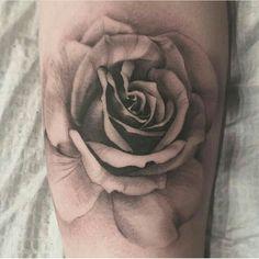 Black and grey rose tatoo