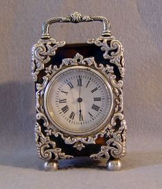 Antique English silver mounted tortoiseshell carriage clock. - Gavin Douglas…