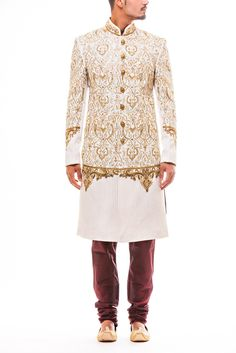 Stunning Gold Kasab and Zari work Wedding Sherwani on White Tussar Silk paired with Maroon Churidaar