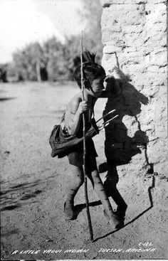 Yaqui boy pictured with his arrows