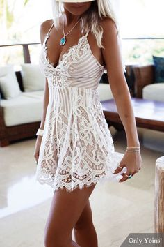 In summer, you should buy at least one piece this sexy mini dress. Don't miss this white sleeveless playsuit. It is designed with sleeveless, open back, lace-up at back and lace details. Finish you fashion look with high heels.