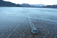 "Mystery solved: 'Sailing stones' of death valley seen in action for the first time. As nighttime temperatures plummet, the pond freezes to form thin sheets of ""windowpane"" ice, which must be thin enough to move freely but thick enough to maintain strength. On sunny days, the ice begins to melt and break up into large floating panels, which light winds drive across the playa, pushing rocks in front of them and leaving trails in the soft mud below the surface.    bg"
