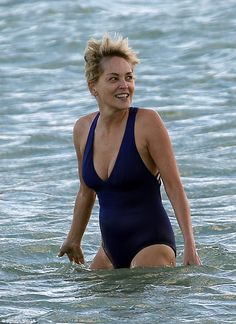Amazing: The Basic Instinct star looked far younger than her years in the tight blue swimsuit, which displayed her ample cleavage