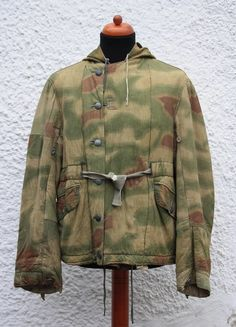 A more than beautiful and worn reversible Sumpftarn parka with many different cammo variations. The hood also appears to be bigger than on other parkas I own/have owned