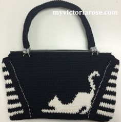 Cat stretching!  Check out the crochet purse pattern on Etsy!