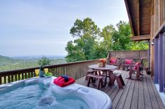 Amazing Views --  Relax in the hot tub or grab a cup of coffee and sit in one of the chairs on the deck while soaking in the amazing views of the Smoky Mountains.