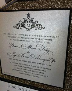 Gold glitter wedding invitations in Black Envelopments pocketfold.