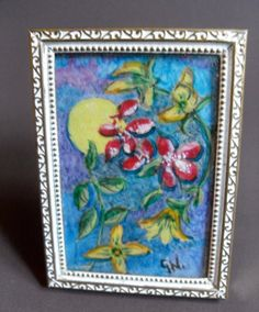 """B7441 £32 or offer + postage. A fairly contemporary framed hand painted miniature of red and yellow flowers set against a background of blue sky with sun.  The miniature is signed to the bottom off centre the initials GN (a local Isle of Wight artist G Nicholls).  The frame measures approximately 2.875"""" by just over 2"""" and the visible painting about 2.375"""" by 1.625"""". The frame is sound but could be better and needs a little adjustment to stand up with the support. Exact age unknown."""