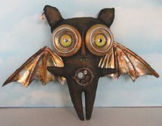 """Thaddeus  You'll be cutting up some aluminum drink cans to form the eyes and wings of this 11"""" x 13"""" Steampunk Bat."""