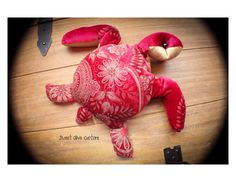 This is a listing for the exact hug turtle pictured . Beautiful and unique red velour - sequins - satin fabric. Hand sewn glass beaded eyes