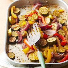 Peacock Vegetables  Balsamic vinegar, olive oil and herbs coat roasted vegetables in this colorful side dish.