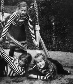 Grand Duchesses Tatiana, standing, Maria, and Anastasia play on a swing during a summer cruise in Finland in 1908
