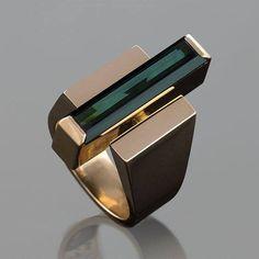 A Danish Modernist 18 karat gold ring centering on a 4.30 carat green tourmaline by George Jensen & Wendel.