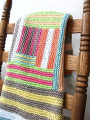 Crazy Cabin Baby Blanket Pattern from AnniesCatalog.com -- A new take on an old classic, this baby blanket is done log-cabin style, but with irregular blocks and lots of fun stripes. With the wide color choice, this pattern is definitely applicable for a baby girl or boy.